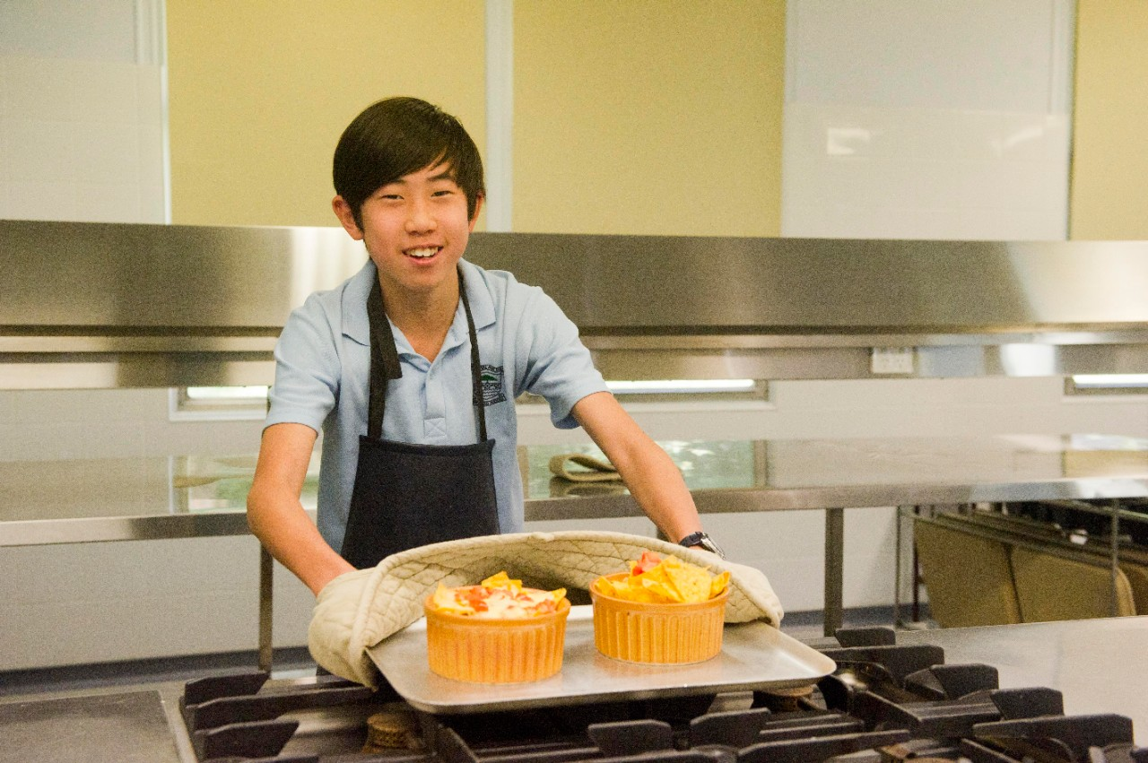 Student showcasing food.